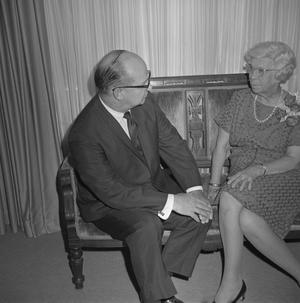Primary view of object titled '[Dr. Helen Hewitt and an unknown man]'.