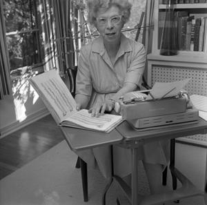 Primary view of object titled '[Dr. Helen Hewitt, sitting at her desk]'.