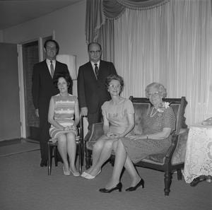 Primary view of object titled '[Dr. Helen Hewitt sitting with four unknown people]'.