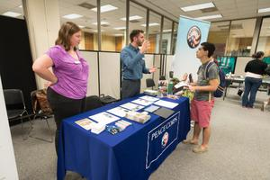 Primary view of object titled '[Peace Corps table at the LGBTQIA Career Fair, 2]'.