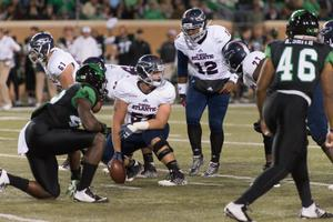 Primary view of object titled '[UNT Football Players on the Field]'.