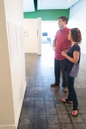 Primary view of [Julie Judkins and Kevin Hawkins, viewing art at the Diane E. Williams Reception]