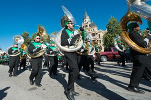 Primary view of object titled '[North Texas marching band in front of the Denton courthouse]'.