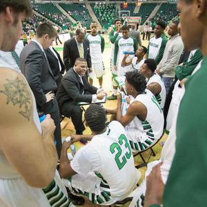Primary view of object titled '[UNT Basketball Teammates Discuss Plays with Coach Tony Benford]'.
