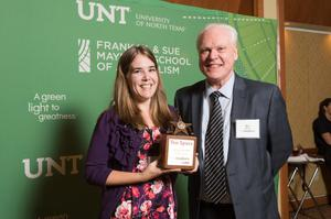 Primary view of object titled '[Lindsey Bacon Bertrand Holding First Place Trophy with Bob Mong]'.