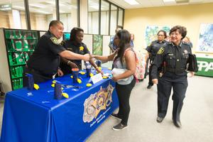Primary view of object titled '[Police officers at the LGBTQIA Career Fair]'.