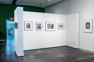 Primary view of object titled '[Four Photographs in an Exhibit Alcove]'.