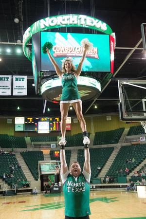 Primary view of object titled '[Two UNT Cheerleaders Rallying Crowd]'.