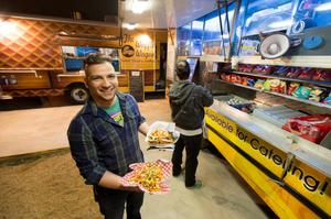 Primary view of object titled '[Victor O. Guevara at the Say Kimchi food truck]'.