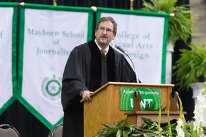 Primary view of object titled '[UNT Faculty Staff Giving Speech at the Fall 2014 Undergraduate Commencement Ceremony]'.