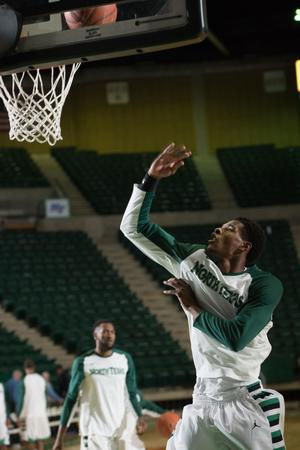 Primary view of object titled '[UNT Basketball Player Armani Flannigan]'.
