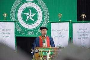 Primary view of object titled '[Warren Berggren speaking at Masters Commencement]'.