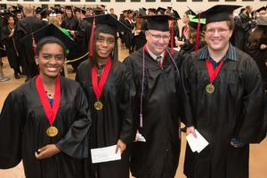 Primary view of object titled '[Students Pose for Photo at the Fall 2014 Undergraduate Commencement Ceremony]'.