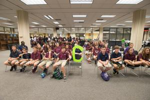 Primary view of object titled '[Westlake Academy Charter School students sitting in the Willis Library]'.