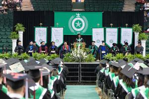 Primary view of object titled '[Student Gives Speech to Fellow Peers at the Fall 2014 Undergraduate Commencement Ceremony]'.