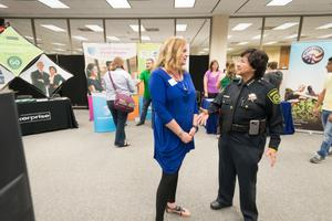 Primary view of object titled '[Female police officer at the LGBTQIA Career Fair, 2]'.