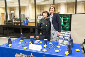Primary view of object titled '[Dallas Police officer at the LGBTQIA Career Fair]'.