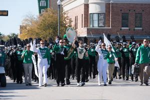 Primary view of object titled '[North Texas Marching Band in the Homecoming Parade]'.