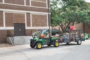 Primary view of object titled '[University of North Texas facilities and landscaping worker's truck]'.