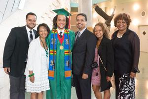 Primary view of object titled '[Undergraduate student and his family at commencement]'.