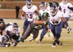 Primary view of object titled '[UNT Football Player Running with Ball]'.