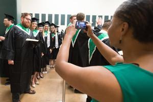 Primary view of object titled '[Students backstage at Commencement]'.