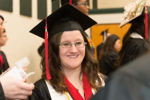 Primary view of object titled '[Candid Photo of Young Woman at the Fall 2014 Undergraduate Commencement Ceremony]'.