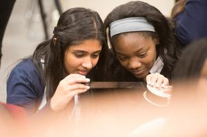Primary view of object titled '[Westlake Academy Charter School students look at microfilm]'.