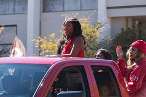 Primary view of object titled '[2014 Homecoming Queen Riding in the Parade]'.