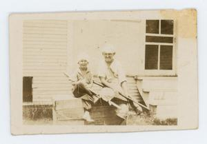 Primary view of object titled '[Photo of Charles and Byrd Williams III from the Byrd Williams III scrapbook]'.