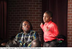Primary view of object titled '[Curtis King on Stage with Young Performer]'.