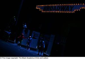 Primary view of object titled '[Performers in darkness on stage]'.