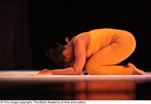 Primary view of object titled '[Dancer curled on stage]'.