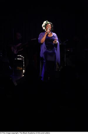 Primary view of object titled '[Singer dressed in purple]'.