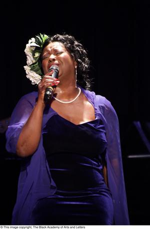 Primary view of object titled '[Singer dressed in purple in spotlight]'.