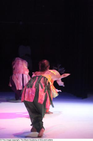 Primary view of [Ensemble in colorful costumes dancing]