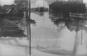Primary view of object titled '[Postcard of Railroad Street During 1913 Flood]'.