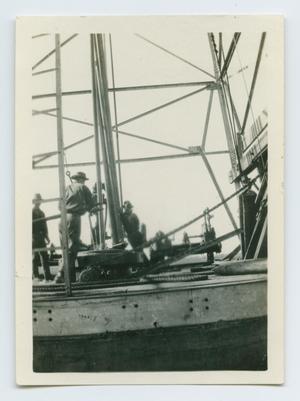 Men Standing on Oil Rig