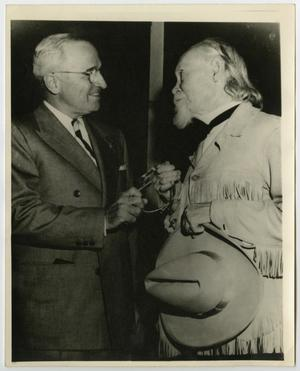 Primary view of object titled '[Photograph of Harry Truman and Sam Myres]'.
