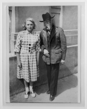 [Photograph of Sam Myres and a young woman]