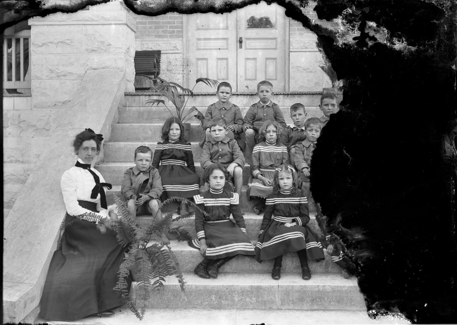 [Group Portrait of Schoolchildren and Teacher on Steps]                                                                                                      [Sequence #]: 1 of 1
