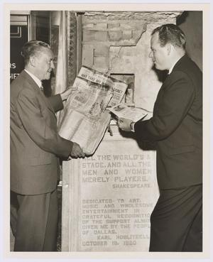 Primary view of object titled '[Robert White and Raymond Willie pose in front of Majestic Theatre time cornerstone]'.