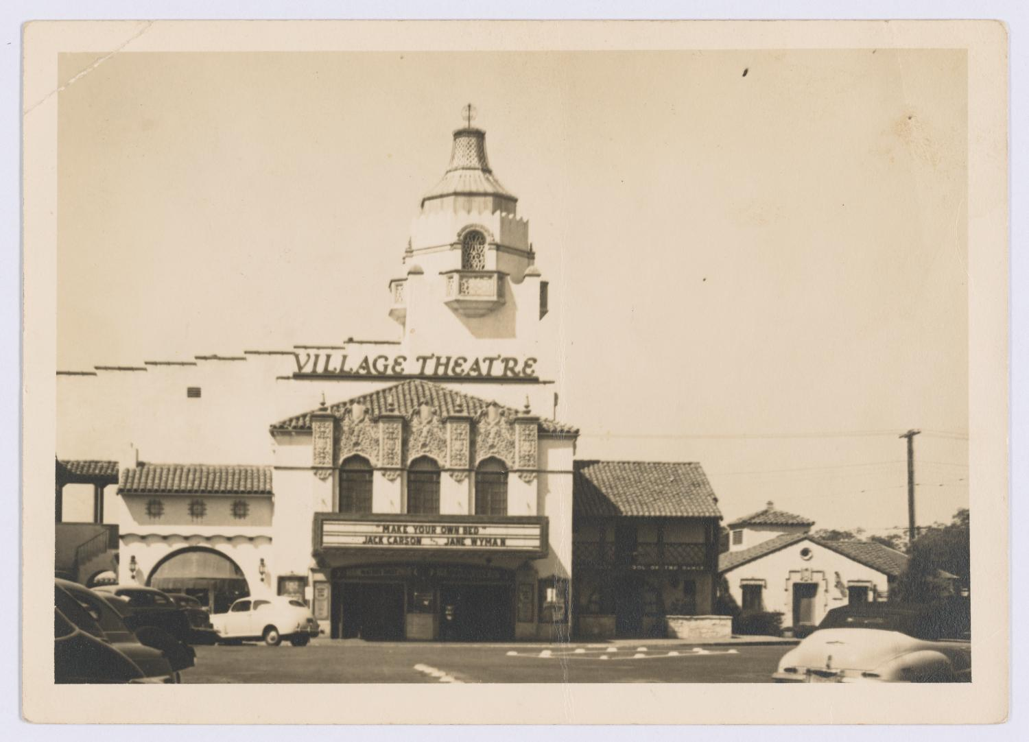 "[Exterior of Village Theatre], Photograph of the exterior of the Village Theatre in Dallas, Texas. The theater marquee advertises the film ""Make Your Own Bed"" with Jack Carson and Jane Wyman.,"