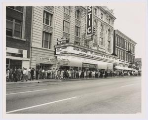 Primary view of object titled '[People lined up under Majestic Theatre marquee]'.