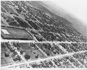 Primary view of object titled '[Aerial view of Rosenberg with a football field to the left of the photo]'.