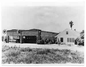 Primary view of object titled '[View of Texaco Station and House]'.