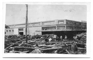 Primary view of object titled '[Storm Damage at Reed Auto Company]'.