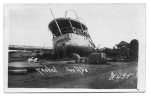 [Boat Damaged from Storm]