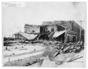 Primary view of object titled '[Storm Damage at E. H. Caldwell and Son Mercantile]'.