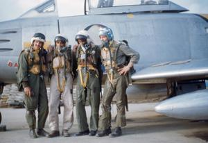[Four Pilots in Front of a Plane]